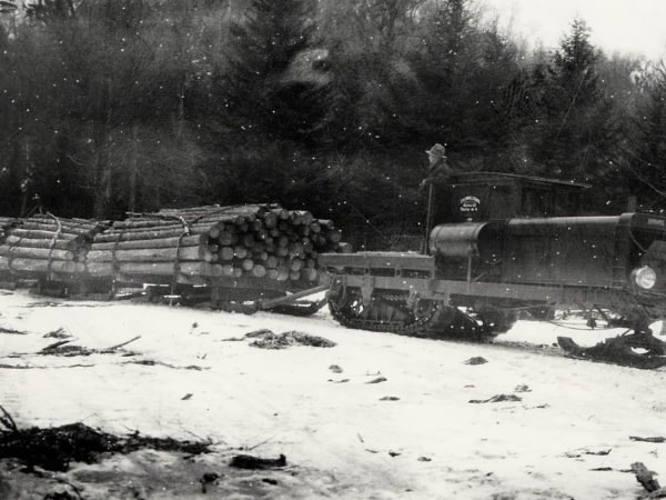 Hauling logs with a Lombard Log Hauler to Partlow in Long Lake
