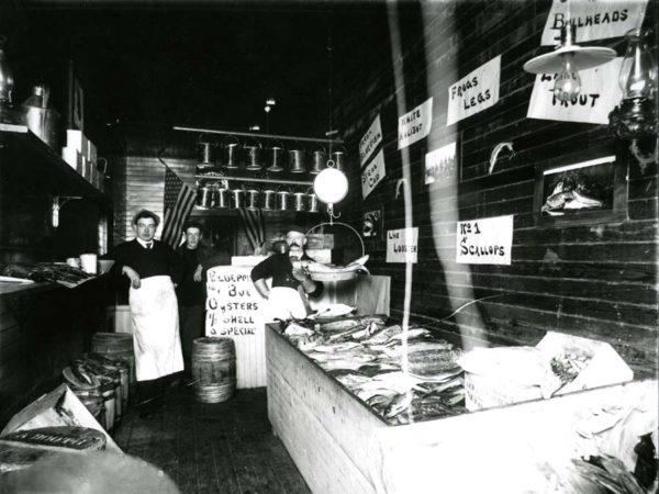 Employees inside fish market in Saranac Lake