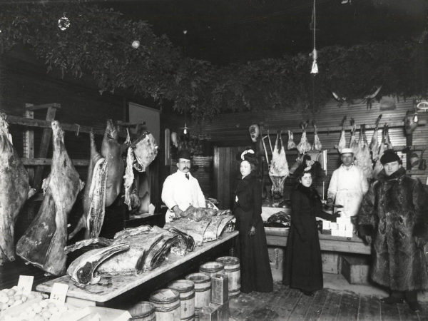 Women shop in a meat market in Saranac Lake