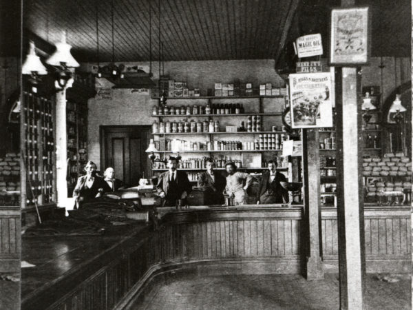 Men behind the counter of the Rogers Company Store in Au Sable Forks