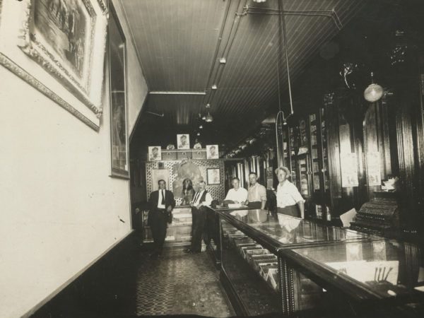 Five men inside J.C. White's Cigar Store in Glens Falls