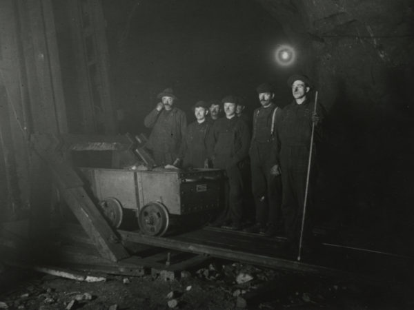 Miners with an ore car inside the Joker Mine in Mineville