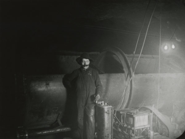 Man with ore car at the Republic Steel Corporation's plant in Mineville