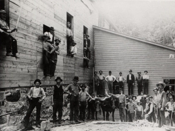 Men outside the graphite mill at Hoopers Mine in North River