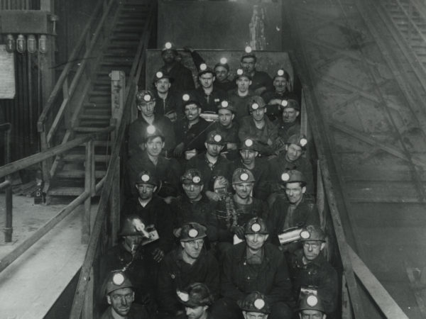 Miners in man cages at Republic Steel Company mine in Mineville