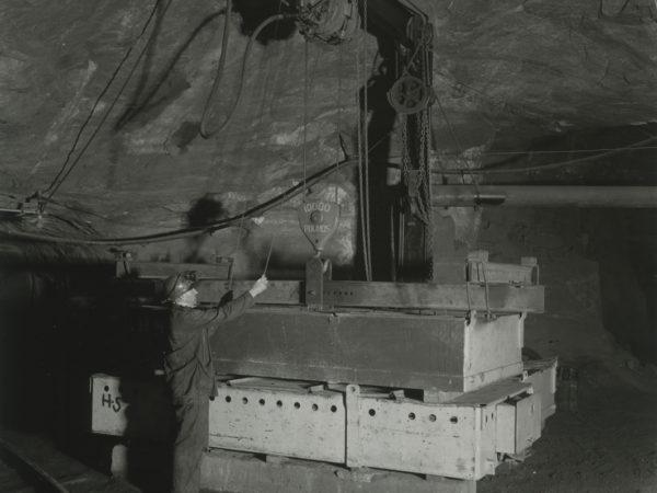 Bert Bruno operates hoist inside a Republic Steel Company mine in Mineville