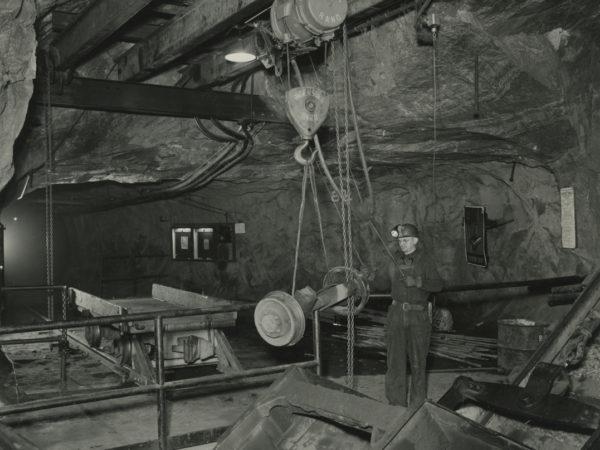 Worker moves ore car wheels in a Republic Steel Company mine in Mineville
