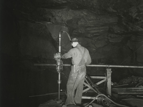 Miner operates drill in Republic Steel Company mineshaft in Mineville