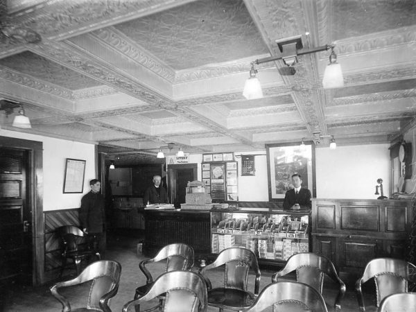 Three men inside the Hotel Chateaugay in Chateaugay