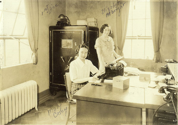 Elizabeth Albright and Mary Casey in office of Gladd Brothers Garage in Saranac Lake