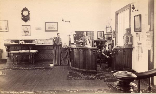 Three men in the office of the Wayside Inn in Luzerne