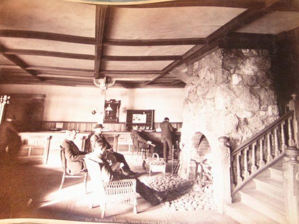 Men inside the lobby of the Wawbeek Lodge in Saranac Lake