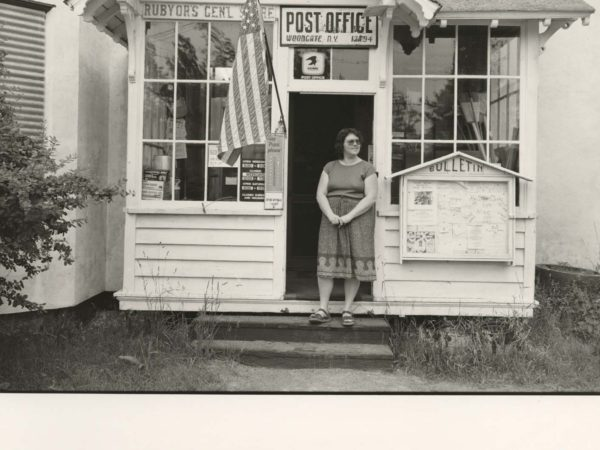 Linda Sturtevant on the front steps of Rubyor's General Store and Post office in Woodgate