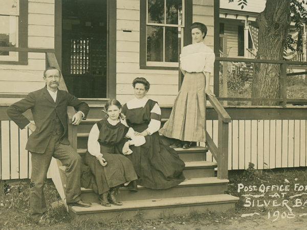 Workers on the steps of the post office in Silver Bay