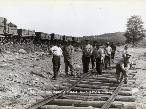 Building the railroad by the barge canal dam in Hinckley