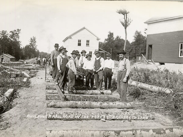 Group of men building a logging railroad in Brandreth Lake