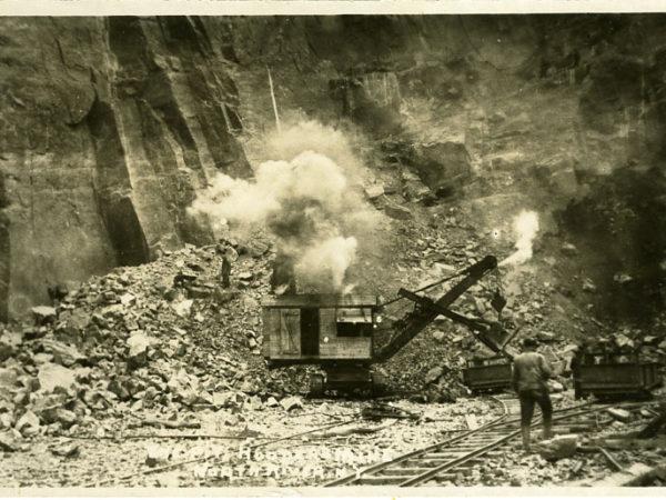 Steam shovel loads ore into ore cars at Hooper's Mine in North River