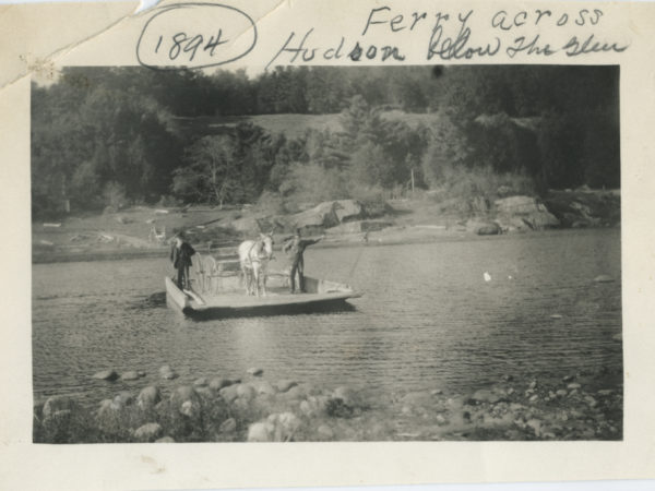 Men and horse on a cable ferry across the Hudson River