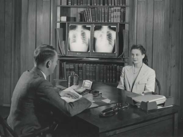 Doctor visits with a patient in the Ray Brook State Tuberculosis