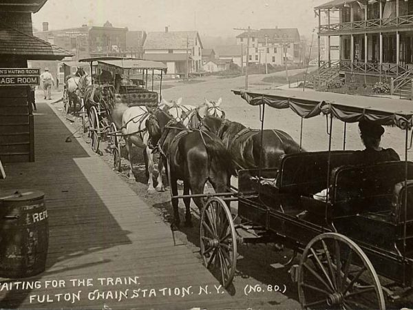 Horse-drawn carriages wait outside the train station in Thendara