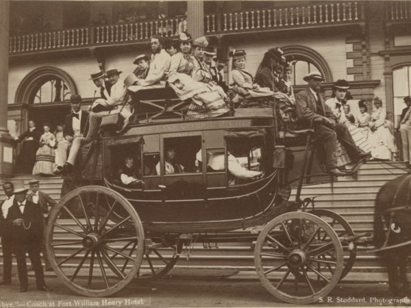 Women and men on top of stagecoach at the Fort William Henry Hotel in Lake George
