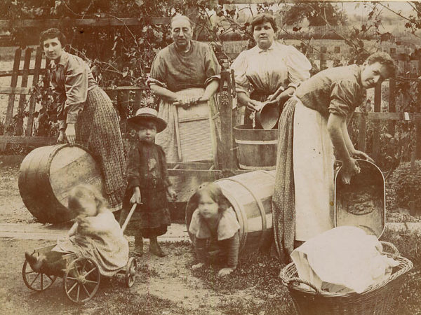 Women doing laundry in a yard in the Adirondacks