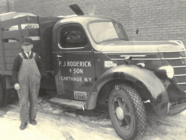 F.J. Roderick with his truck in Carthage