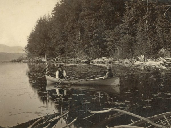 Two men in an Adirondack guideboat in Paul Smiths