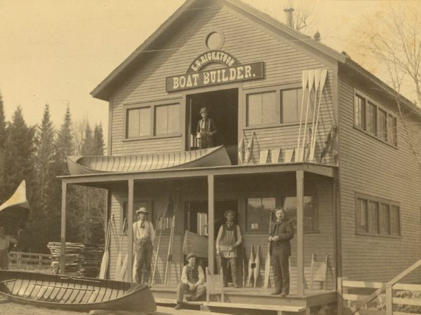 Men in front of the E.G. Ricketson Boat Building shop in Bloomingdale
