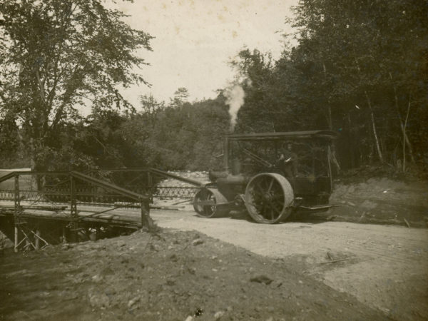 Operating a steam roller for railroad construction in Glens Falls