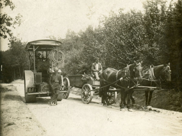 Workers for the D.E. Van Wirt Construction Co. with a horse-drawn dump wagon and steam roller