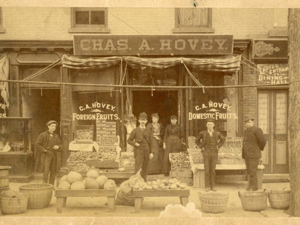 Employees in front of Chas. A. Hovey's store in Glens Falls