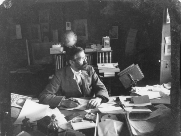 Seneca Ray Stoddard at his desk in Glens Falls