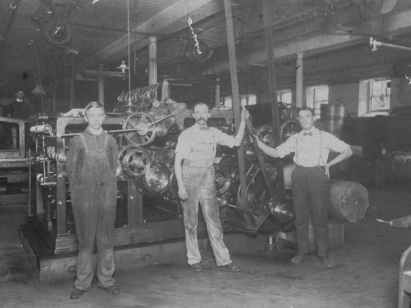 Three workers in the Morning Star print shop in Glens Falls
