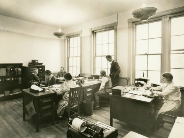 Men and women in an office in the Electric Light Building in Glens Falls