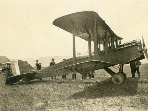 Examining a bi-plane at Aviation Filed in Glens Falls