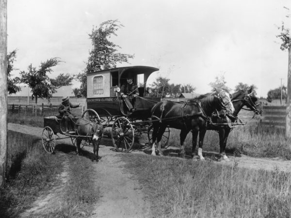 The Rochester Clothing Company delivery wagon near Glens Falls