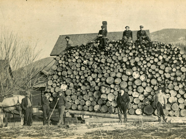 : Men with a load of logs in Keene Valley