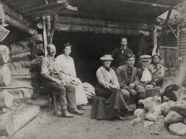 A group at a camp with guide near Keene Valley