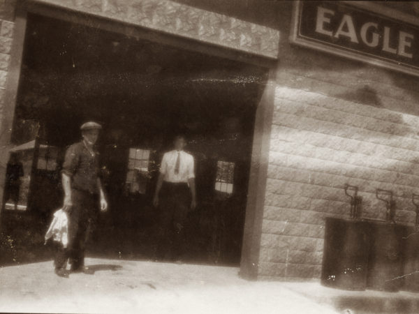 Two men working at the Eagle Garage in Keene Valley