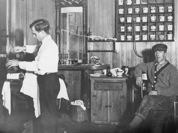 Bert Tyron in his barber shop in Keene Valley
