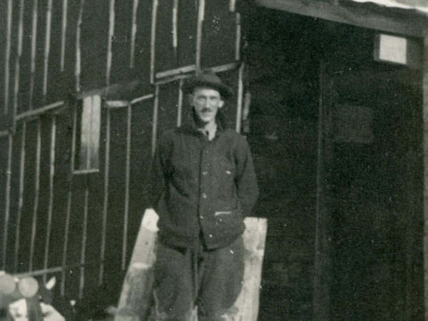 Sam Glover standing outside Lumber Camp III