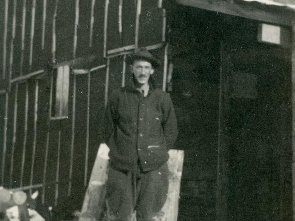 Sam Glover standing outside Lumber Camp III