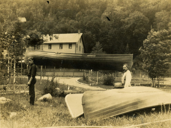 Guideboats and workers outside the Cascade Lakes Hotel in Keene Valley