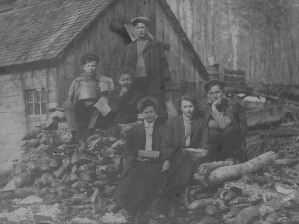 A group gathered at Charles Beedes' sugar camp in Keene Valley