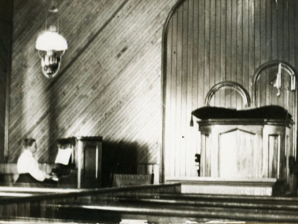 Playing the organ at the Congregational Church in Keene Valley