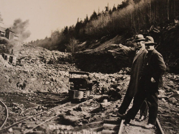 Workers at a garnet mine in North River