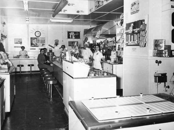 Employees and customers in Altamont Dairy Bar in Saranac Lake