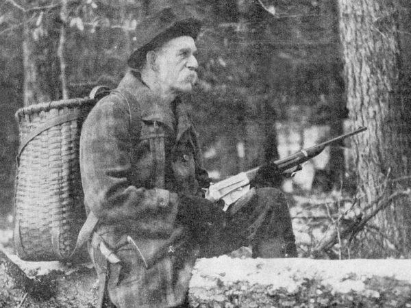 Captain E.E. Thomas hunting with an Adirondack pack basket