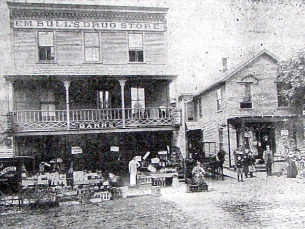 Barr's Delicatessen Store and F.M. Bull's Drug Store in downtown Saranac Lake